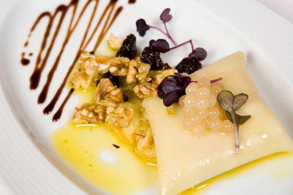 FOIE RAVIOLI, NUTS VINAIGRETTE AND PASSION FRUIT FRESH PEARLS
